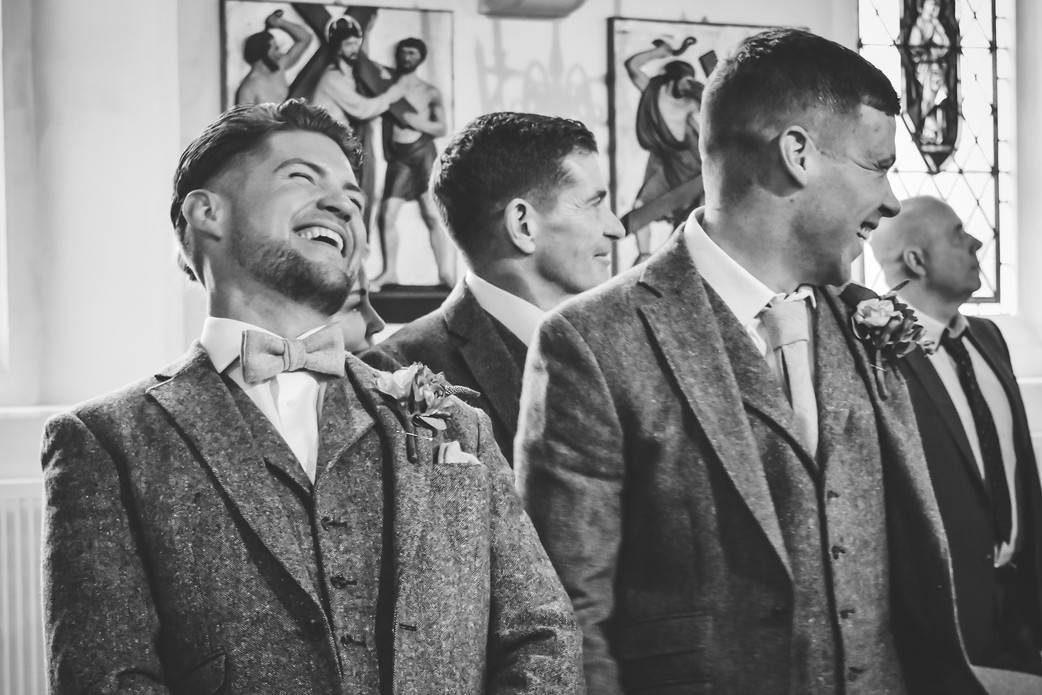 Wedding Photographer Birmingham, the groom laughing with joy as he sees his bride for the first time