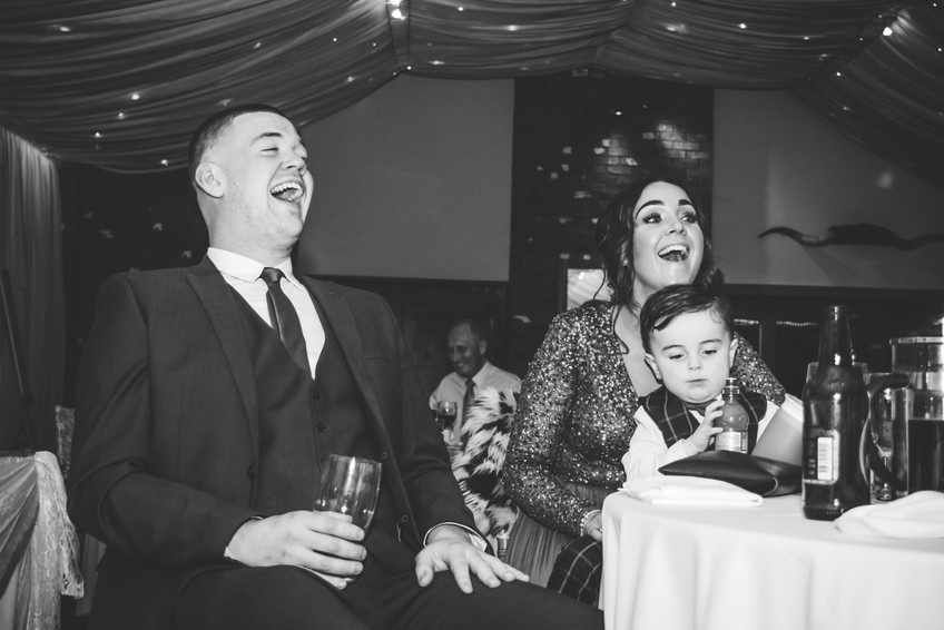 Wedding Photographer Birmingham, natural fun photograph of the guests laughing during the speeches at Wootton Park Warwickshire