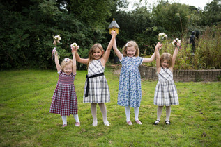 Photography wedding Birmingham, the flower girls holding their hands in the air at the elephant & castle Warwickshire