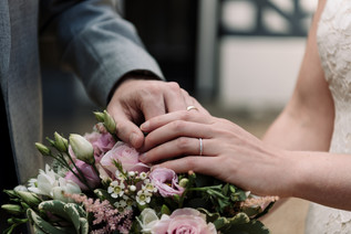 Photographer Wedding Birmingham, close up of the bride & grooms wedding rings on the wedding bouquet at the lord leycester hospital warwick