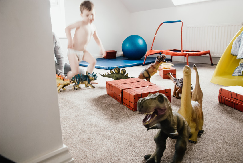 Natural in ho,e photographer Solihull, little boy playing with his toys, autism photographer