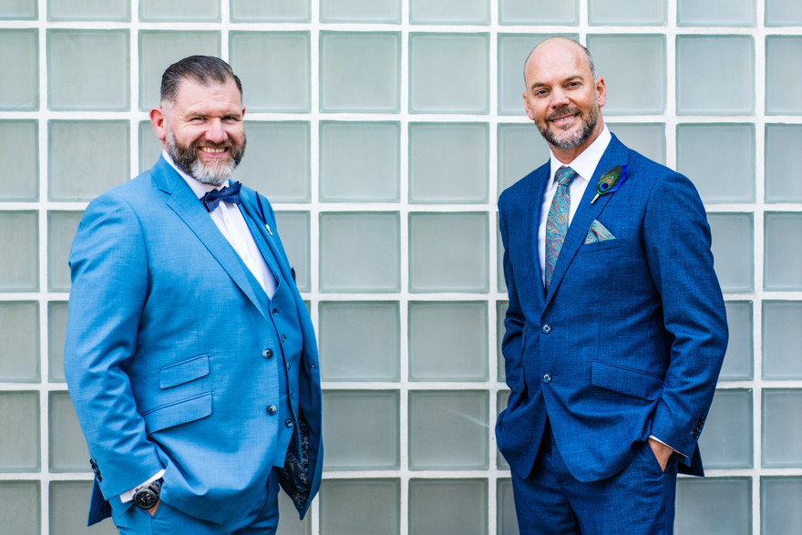 Civil marriage wedding photographer Birmingham, the two grooms standing outside the register office in Birmingham, relaxed photograph
