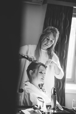 Wedding pHotographer Solihull, bridesmaid having her hair done during the preps for a wedding at Westmead hotel Birmingham