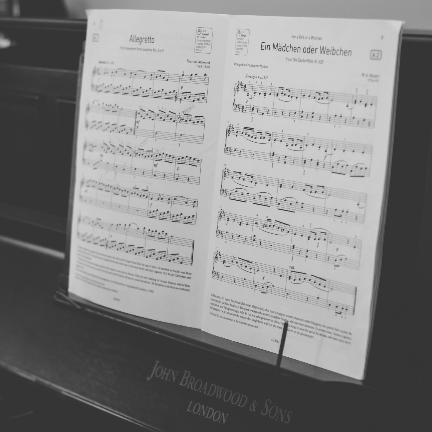 Lifestyle photographer Birmingham, close up of a music sheet on a piano, black & white image