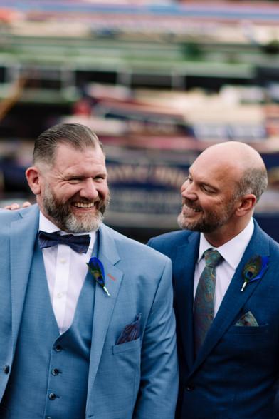 Civil Wedding Photographer Birmingham, the grooms sharing a joke, fun relaxed photography