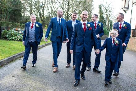 Fun wedding photographer Birmingham, groom & grooms men walking towards the camera, informal photograph at the Westmead hotel Birmingham
