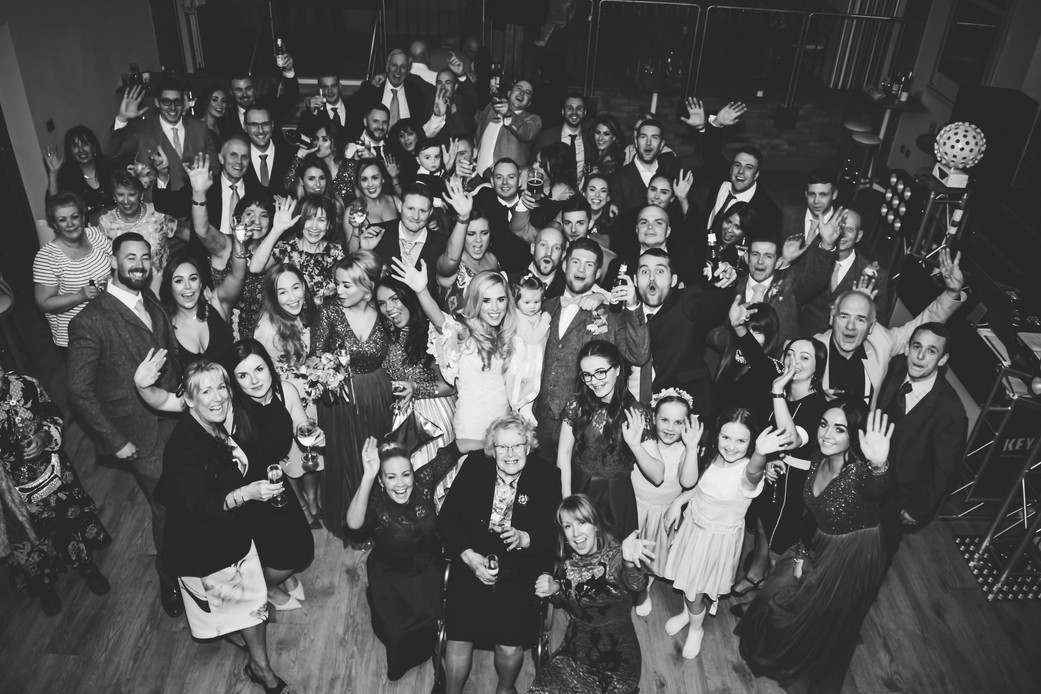 Wedding Photographer Warwickshire, a big group photograph of all the guests photographed from above in Black & white at Wootton Park Henley in Arden