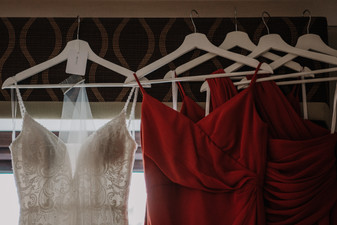 Solihull Wedding Photographer, the bride & bridesmaids dress hanging from the window at The Westmead Hotel Birmingham