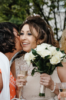 The Limes Wedding Photographer Solihull, Wedding Photographer Birmingham, the bride being kissed by one of her guests, fun natural photograph
