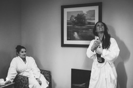 Wedding Photographer Solihull, the bridesmaid opening a bottle of champagne during the preparations at The Westmead Hotel Birmingham