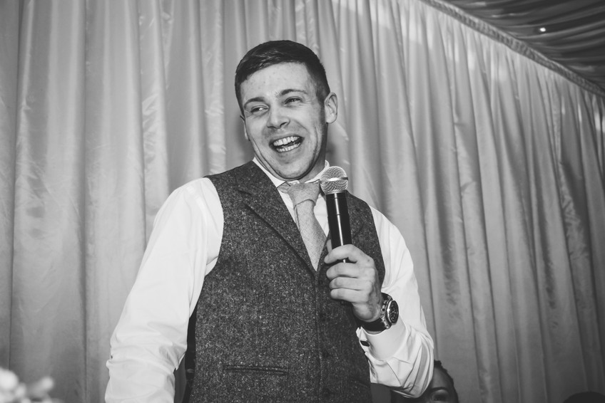 Wedding Photographer Birmingham, natural fun photograph of the guests laughing during the speeches, best mans speech at Wootton Park Warwickshire