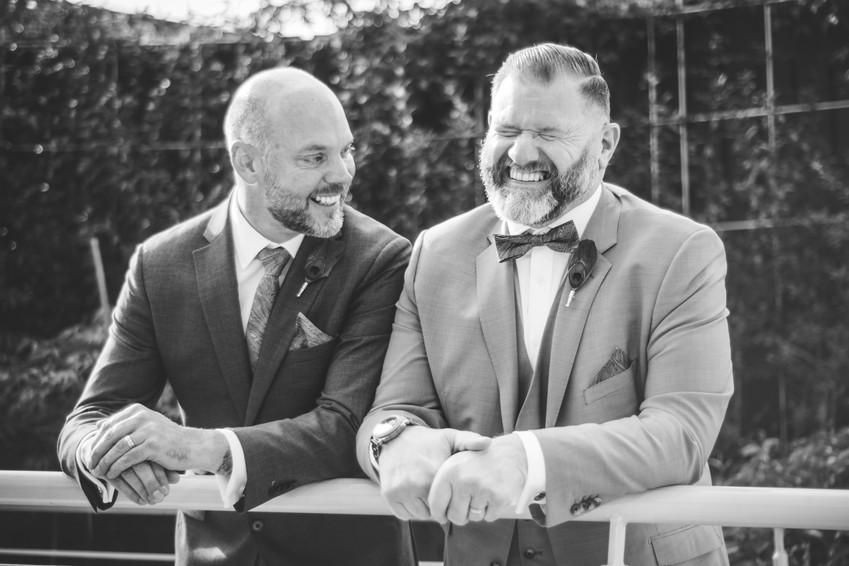 Wedding Photographer Birmingham, fun, natural photograph of the grooms sharing a joke, black & white informal photography