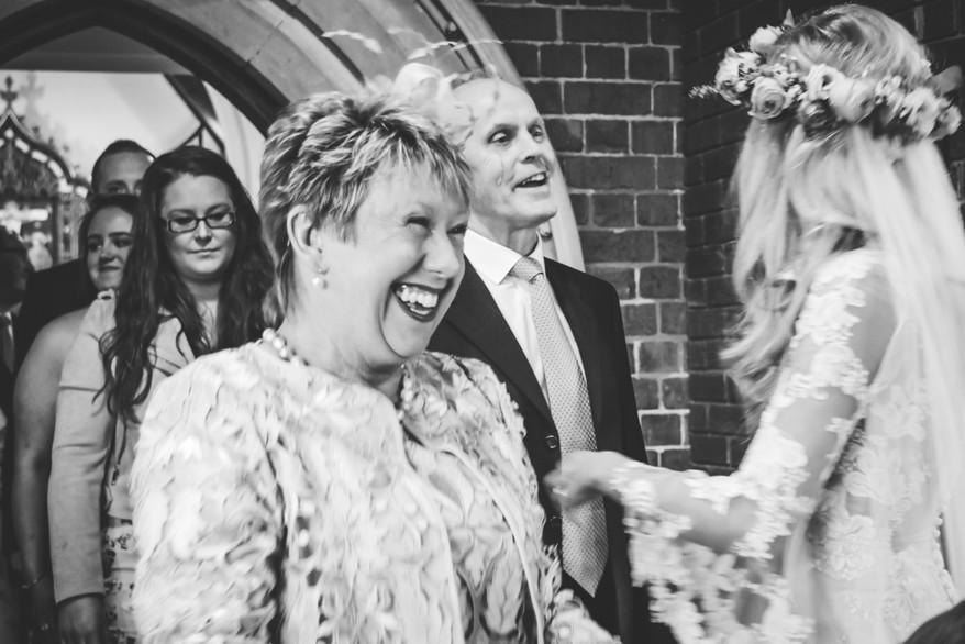 Wedding Photographer Birmingham, bride & groom greeting their guests after their wedding, fun natural photographs