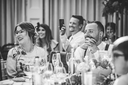 Hampton Manor Photographer Solihull, guests laughing during the speeches, fun wedding photograph