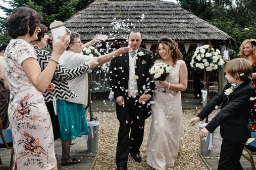 The Limes Solihull Wedding Photographer, confetti photograph, second time round wedding photographer Solihull, Wedding Photographer Birmingham, bride and groom walking down the aisle after the ceremony