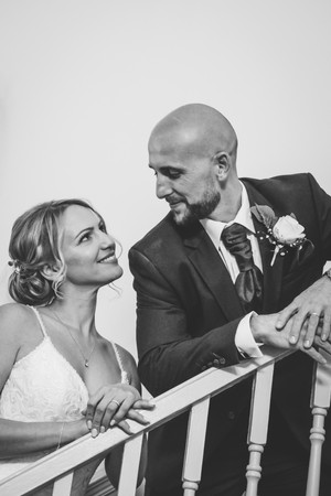 Wedding Photographer Solihull, the bride & groom looking at each other on the stair case at the Westmead Redditch, winter wedding photograph