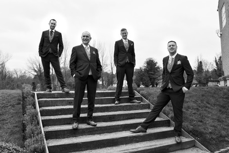 Wedding Photographer Birmingham. the groom & groomsmen standing in a modern group pose at the west mill derby