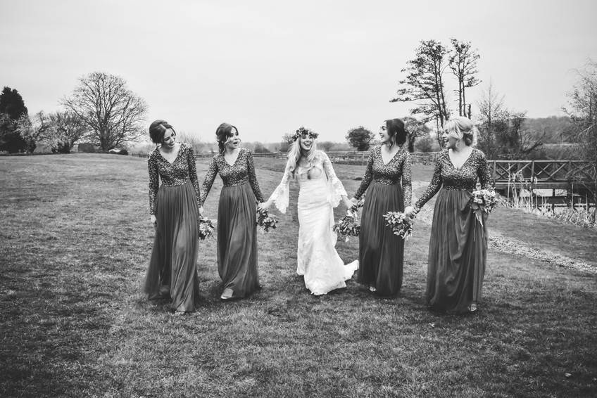 Wedding Photographer Birmingham, boho wedding photograph of the bride with her bridesmaids walking towards the camera, black & white photograph at Wootton Park Henley in Arden