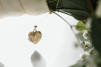 Wedding Photographer Birmingham, a little heart pendant with I love you written on it at The Westmead Hotel Birmingham