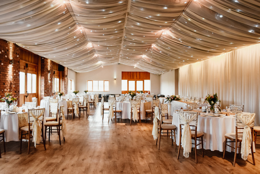 Wedding Photographer Birmingham, Wooton Park wedding vene, wide shot of the room set up for the wedding breakfast