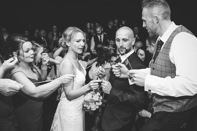 Wedding Photographer Birmingham, bride & groom lighting the sparklers at a wedding at Westmead hotel Birmingham