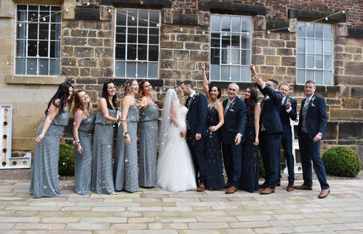 Wedding Photographer Solihull, the bridal party throwing confetti at the West Mill Derby