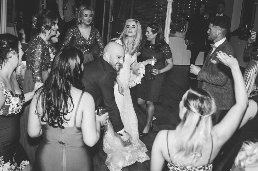 Wedding Photographer Birmingham for non traditional couples, wedding guests laughing & dancing, bride dancing with guests at Wootton Park Henley in Arden