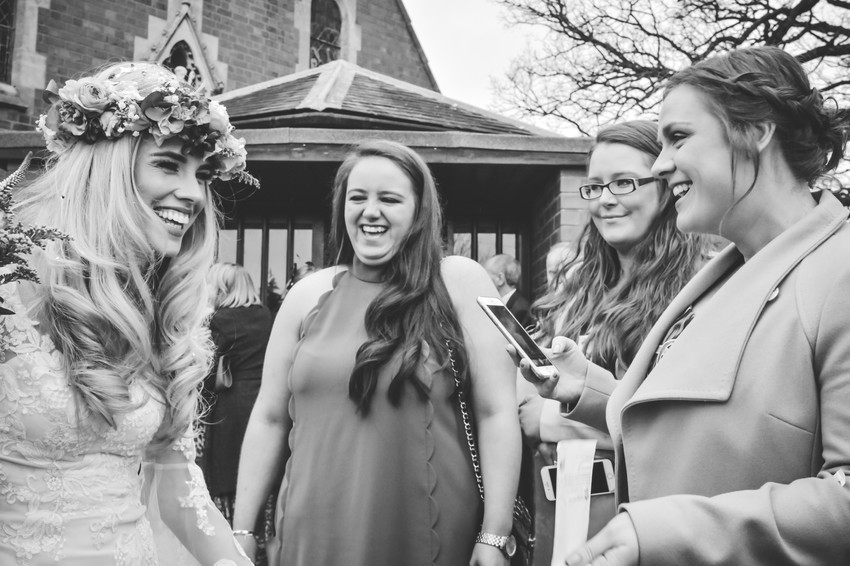 FunWedding Photographer Solihull, the bride with her friends sharing a joke