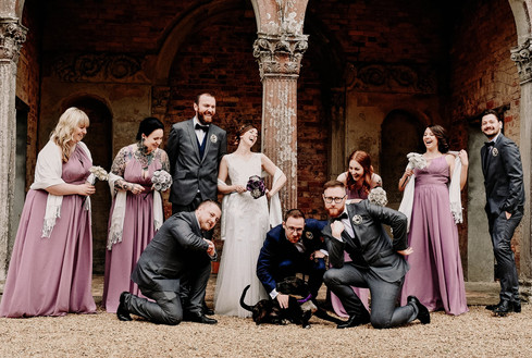 Wedding Photographer Solihull, the bridal party laughing & doing a funny pose at Ettington Hall Stratford