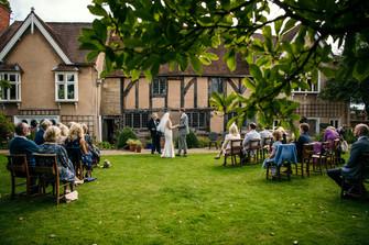Lord Leycester Warwick wedding photographer, the bride & groom echancing vows, outdoor wedding, solihull wedding photography