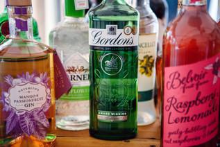 Wedding Photography Birmingham UK, close up image of gin bottles at the wedding reception at the elephant & castle warwick