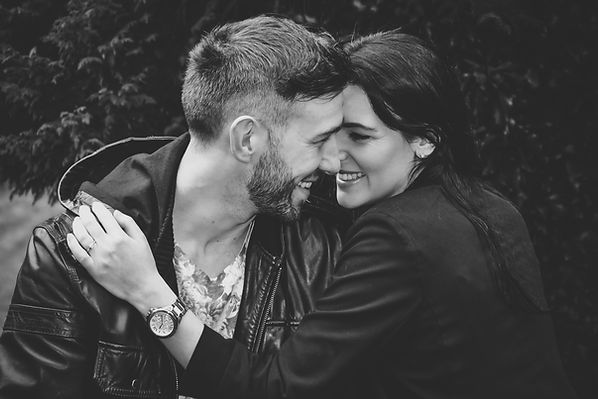 Wedding Photographer Solihull, young couple embracing on an engagement photo shoot, relaxed informal portrait