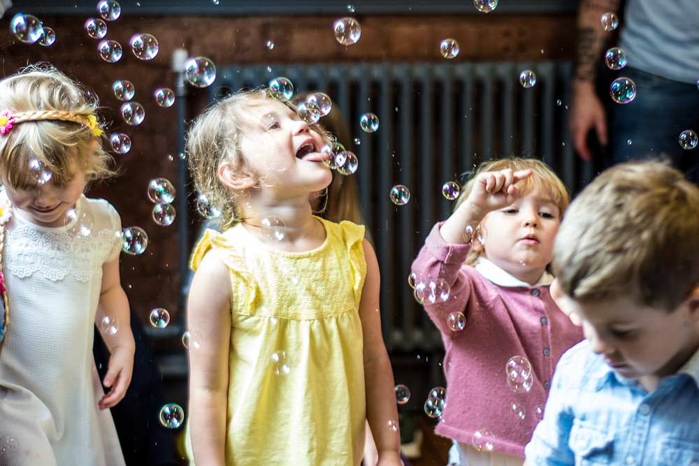 Wedding Photographer Solihull, Birmingham, children playing with bubbles
