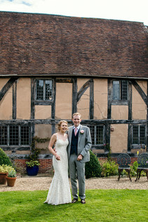 Photography wedding Birmingham, fun image of the bride & groom after the outdoor wedding ceremony at the lord leycester Warwick wedding venue