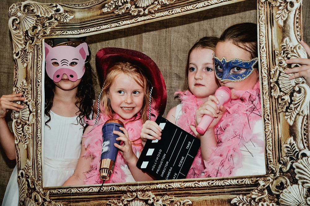 Wedding Photographer Solihull, Birmingham, girls in a photo booth, fun informal photograph