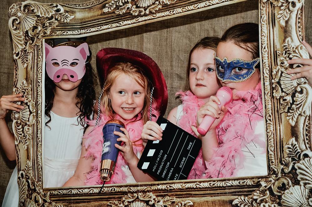 Wedding Photographer Solihull, Birmingham, girls in a photo booth, fun informal photograph