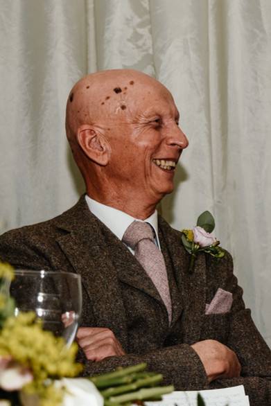 Wedding Photographer Solihull, the father of the bride laughing during the speeches at wootton park warwickshire