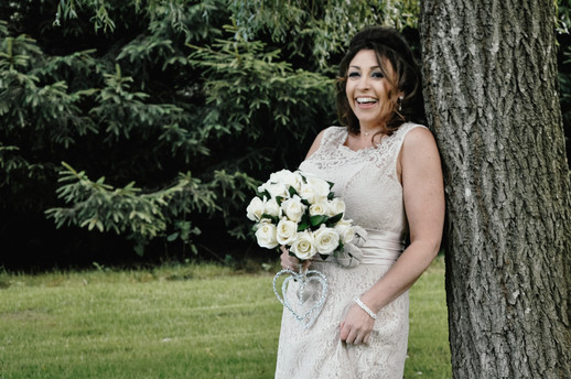 The Limes Wedding Photographer Solihull, Wedding Photographer Birmingham, relaxed photograph of the bride ay her wedding leaning against a tree, happy fun wedding photograph