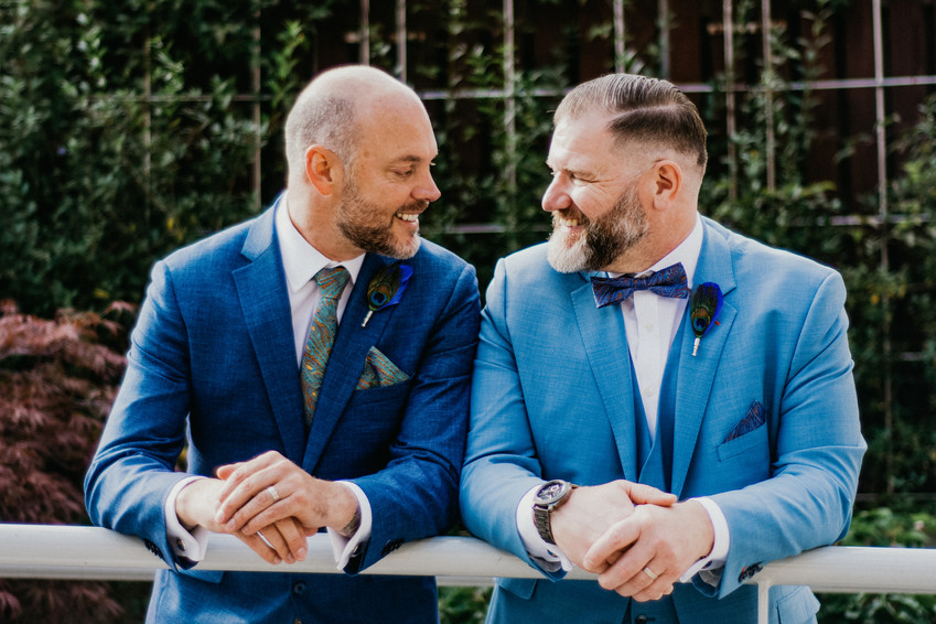 Fun Photographer Birmigham, the grooms looking at each other, natural, relaxed pose