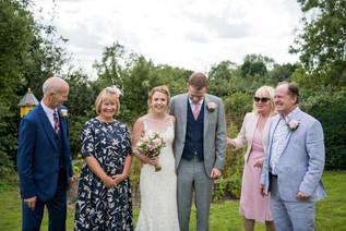 Photography wedding Birmingham, wedding guests laughing at elephant & castle rowington warwickshiren