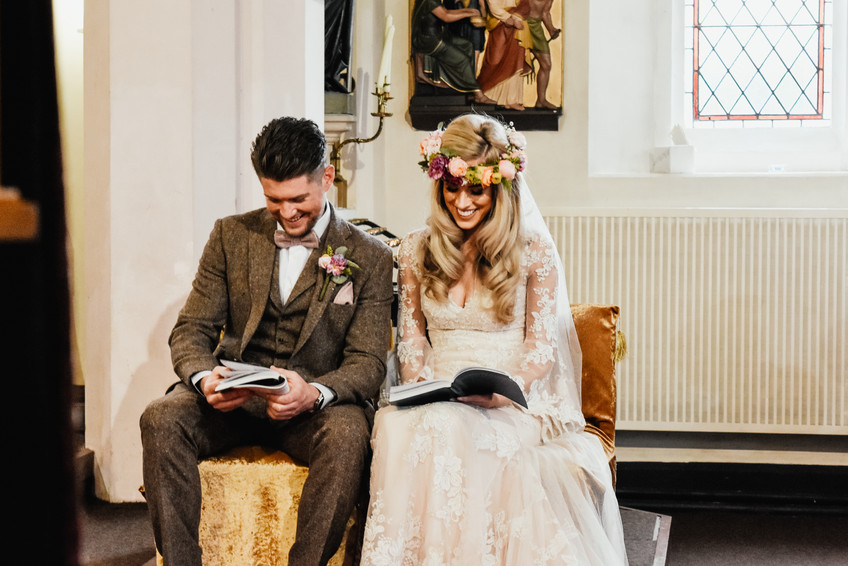 Wedding Photographer Birmingham, the bride & groom sharing a joke during the ceremony