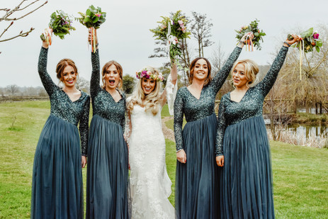 Relaxed Wedding Photography Solihull, the bride & bridesmaids with their bouquets in the air, fun wedding photograph at wootton park Henley in arden