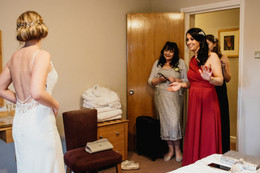 Wedding Photographer Birmingham, the bridesmaids & mother of the bride seeing the bride in her dress for the first time at Westmead hotel Birmingham