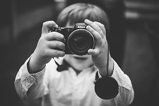 Solihull Family Photographer, little boy taking a photograph of the photographer, balck & white natural photo