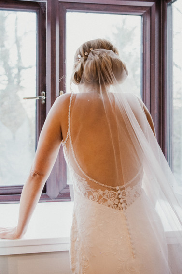 Wedding Photographer Birmingham, the bride looking out of the window before the ceremony at Westmead hotel Birmingham