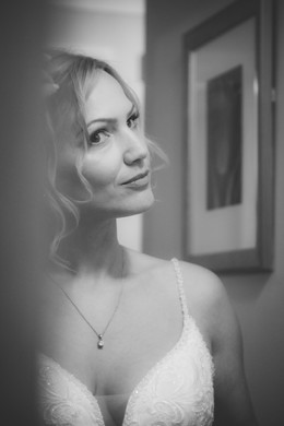 Wedding Photographer Solihull, close up portrait of te bride looking in the mirror at the Westmead hotel Birmingham