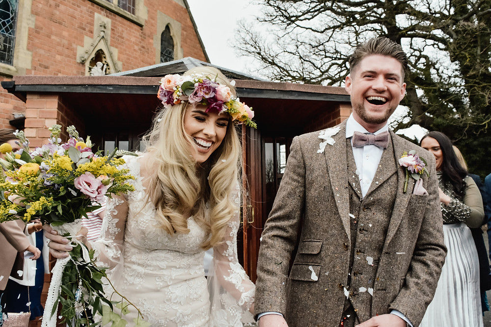 Wedding Photographer Solihull, Birmingham wedding Photographer, Fun photograph of the bride & groom having confetti thrown at them after their wedding