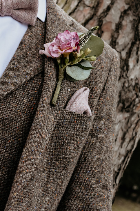 Wedding Photographer Birmingham, close up photograph of the grooms button hole flower at Wootton Park Warwickshire