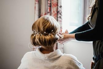 WEdding Photographer Birmingham, bride having her hair done during the preps for her wedding at Westmead hotel Birmingham