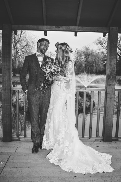 Wedding Photographer Birmingham, boho bride & groom, black & white image looking at each other at Wootton park Warwickshire
